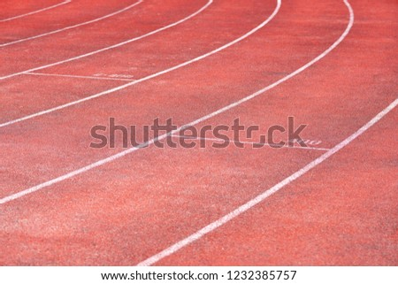 Stadium track for running and athletics competitions. New synthetic rubber treadmill. Empty racetrack. #1232385757