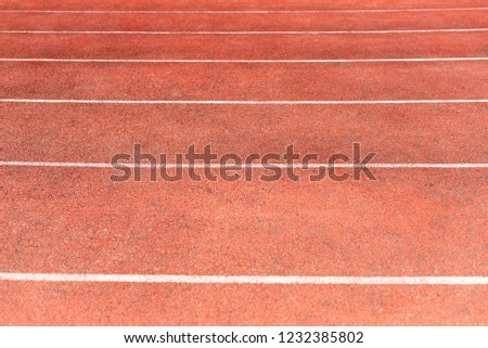 Stadium track for running and athletics competitions. New synthetic rubber treadmill. Empty racetrack. #1232385802
