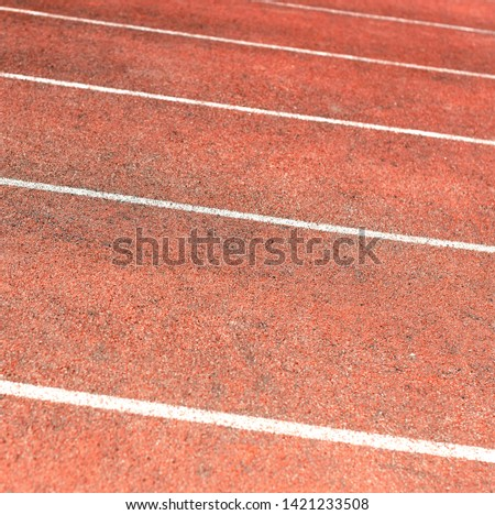 Stadium track for running and athletics competitions. New synthetic rubber treadmill. Empty racetrack.