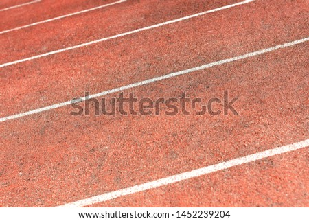 Stadium track for running and athletics competitions. New synthetic rubber treadmill. Empty racetrack. #1452239204