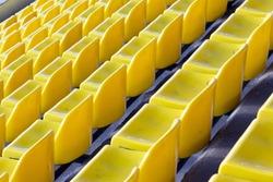 Stadium yellow plastic chairs