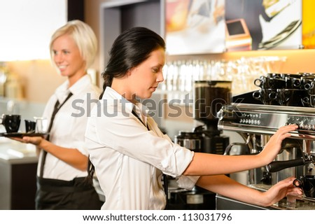 Staff at cafe making coffee espresso machine woman working bar
