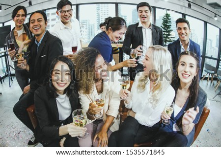 Staff at the office party to celebrate the festival atmosphere of Christmas or New Year. For a party to celebrate the success of the company.Business and celebration concept.