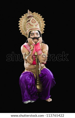 Stage artist dressed-up as Ravana and making a sad face