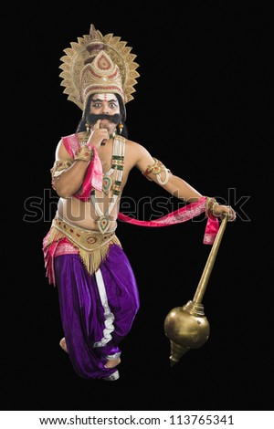 Stage artist dressed-up as Ravana and thinking