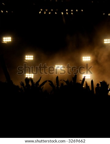 Stage lighting with Silhouette people - stock photo