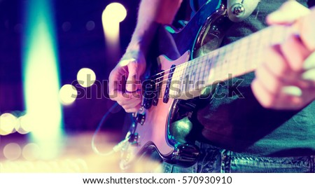 Photo of  Stage lights.Abstract musical background.Playing guitar and concert concept.Live music background.Music festival.Instrument on stage and band