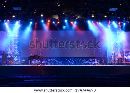 Stage lights before concert with musical instruments