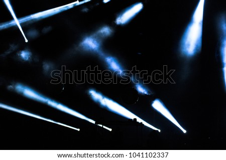 Stage lights during a rock concert. Entertainment industry #1041102337