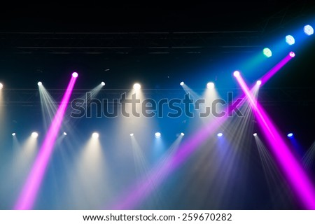 Stage lights on concert. Lighting equipment with multi-colored beams.