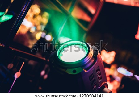 Stage lights or spot lights at the concert, disco, club or bar. Spotlight illuminate the area in the dark background. #1270504141