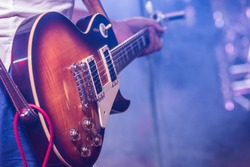 Stage lights.Playing guitar and concert concept.Live music background.Rock concert.Music festival.Instrument on stage and band,bass guitarist.