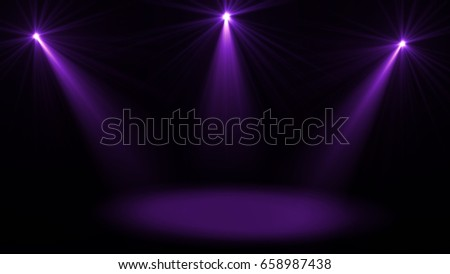 Stage lights. Several projectors in the dark. Purple spotlight strike through the darkness #658987438