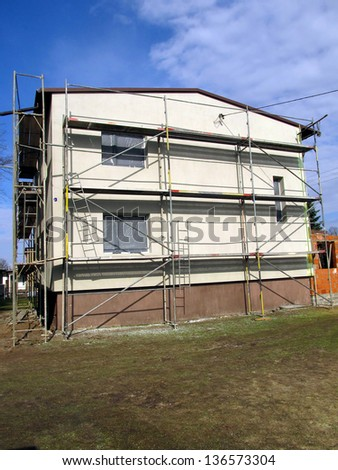 stage of the repaired walls of the building, insulation and renovation of the facade