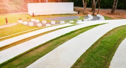 Stage outdoors / stage show with Park bench Cement and pathway in the garden - amphitheater open air