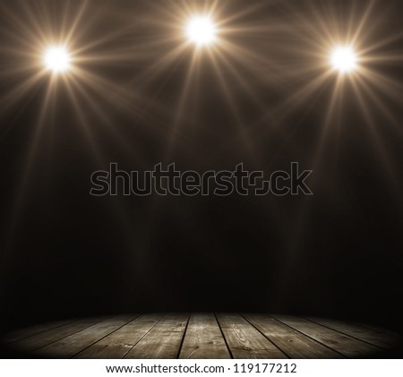 stage spot lighting over dark background