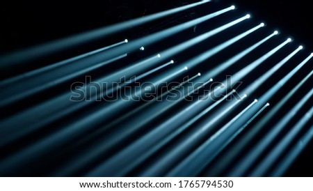 Stage Spotlight with Laser rays. Scene, stage light with colored spotlights. Light beam effects on stage. Stage lights with laser