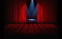 Stage with empty seats and red curtains with bright spotlight