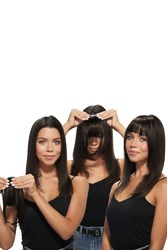 Staged photo of brunette lady which is trying on brown bangs with black side strands. Natural looking bangs are fixing on the clip. Girl in black top is showing three phases of hair extension.