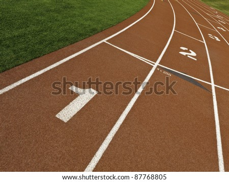 Staggered lane numbers on rubberized surface of all-weather running track