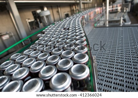 Stain-roof jars with drinks on the assembly line. for the production of alcoholic and soft drinks line. The final stage in the manufacture of the product. #412366024