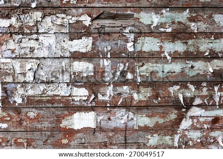 Stained dirty wood planks scratched background. Weathered wood planks is for you design. Obsolete rough backdrop with  spots of white paint and brown bare wood