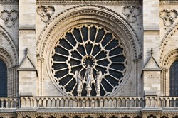 Stained facade window of pre-fire Notre Dame in Paris, France
