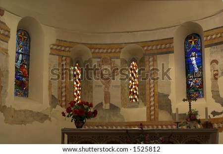 Stained glass behind a church altar in Southern France