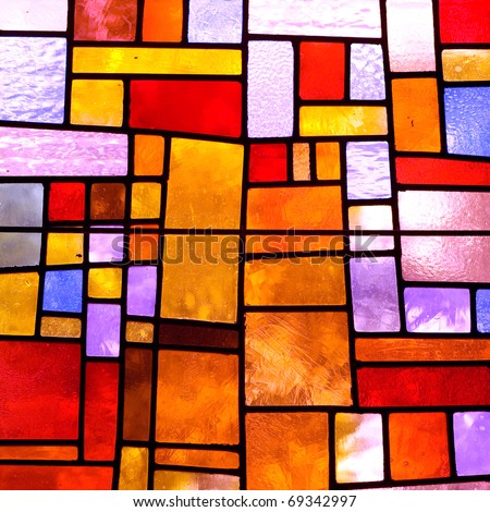 Stained glass church window in a reddish tone square orientation