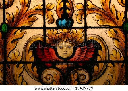 Stained glass depicting face of cherub angel