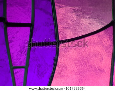 stained glass in colors purple with pink, textured background
