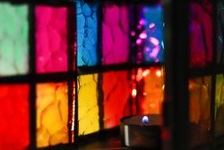 stained glass multi-colored glass of a beautiful lantern with a burning candle