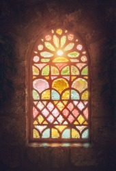 Stained glass window, amazing colorful window of an ancient church, house of god, place of worship, old ancient cathedral of Lebanon