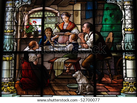 Stained glass window created by F. Zettler (1878-1911) at the German Church (St. Gertrude's church) in Gamla Stan, Stockholm, depicting a Swedish family praying before dinner.