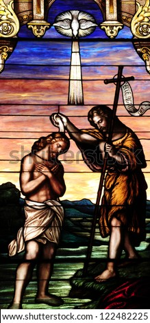 Stained glass window depicting baptism of Jesus Christ by St. John the Baptist