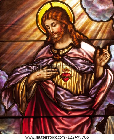 Stained glass window depicting devotion to Sacred Heart of Jesus