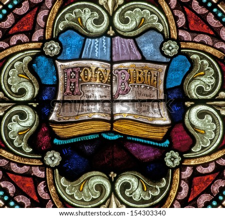 Stained glass window depicting Holy Bible
