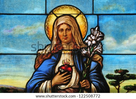 Stained glass window depicting Immaculate Heart of Mary