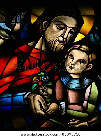 Stained glass window depicting Jesus and a child, in the Koekelberg basilica in Brussels