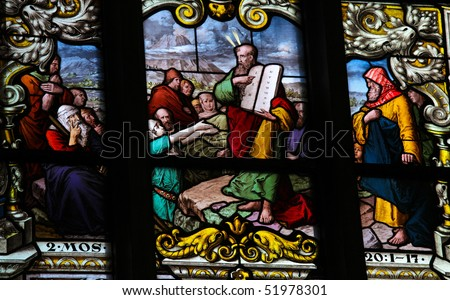Stained glass window depicting Moses showing the Stone Tablets with the Ten Commandments. This window is located in Saint James's Church in Stockholm. It was fabricated in 1893.