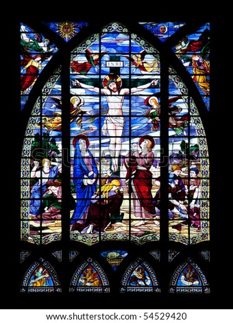 Stained glass window depicting the crucifixion of Jesus Christ.