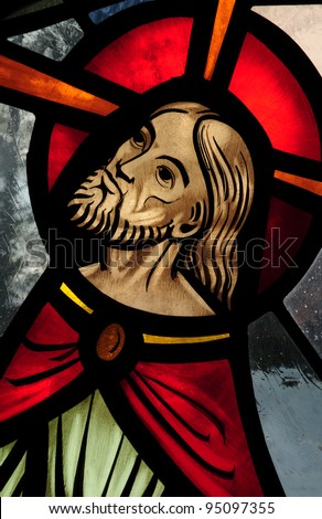 Stained glass window detail of face of Jesus during Agony in the Garden