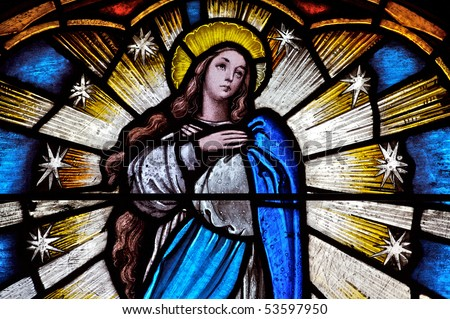 Stained glass window detail of the virgin Saint Mary