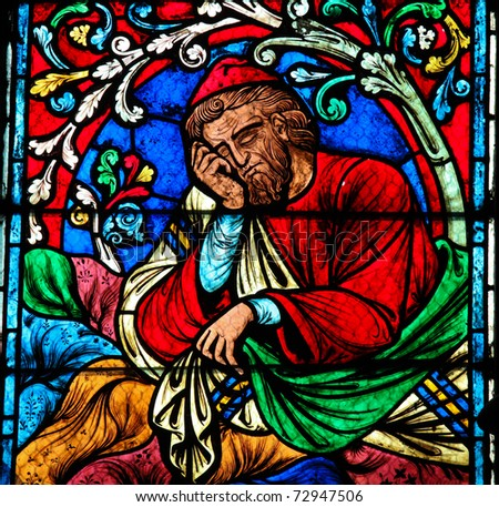 Stained glass window in the Notre Dame Cathedral in Paris, created in the 13th Century, depicting a resting person.