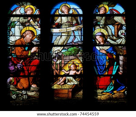 Stained glass window in the Saint-Eustache church in Paris depicting a Nativity Scene.