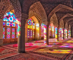 Stained glass window light Nasir al-Mulk Mosque in Shiraz, Iran
