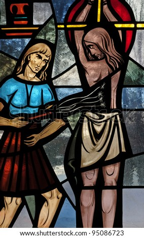 Stained glass window of scourging of Jesus Christ