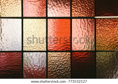 Stained glass window pane in red/orange hue #773532127