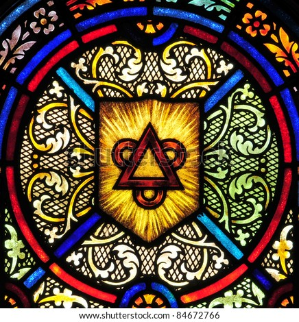 Stained glass window with triangle and circles symbolizing the Holy Trinity
