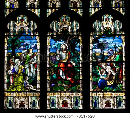 Stained glass windows at church reflecting religious figures